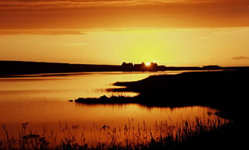 Sunset over Skaill Loch, Orkney.